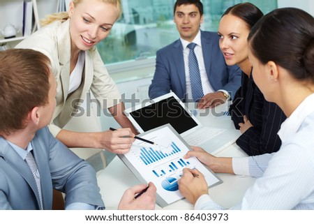 Businesspeople discussing the results of their work - stock photo