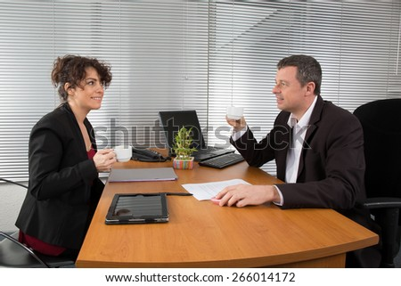 Businesspeople drinking espresso coffee at office