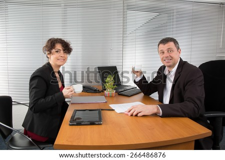 Businesspeople drinking espresso coffee at office - stock photo