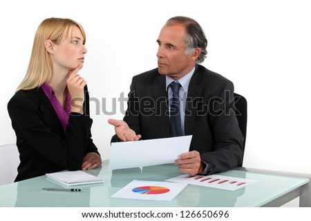 Businesspeople going over statistical data - stock photo