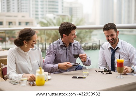 Businesspeople having break from work in a cafe. - stock photo