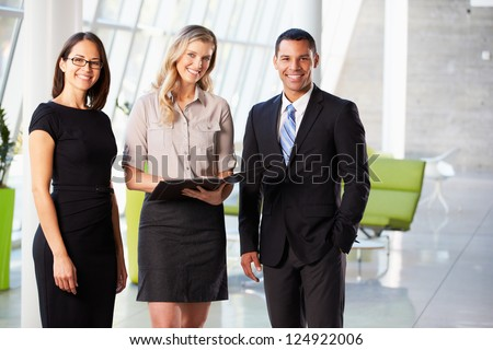 Businesspeople Having Informal Meeting In Modern Office - stock photo