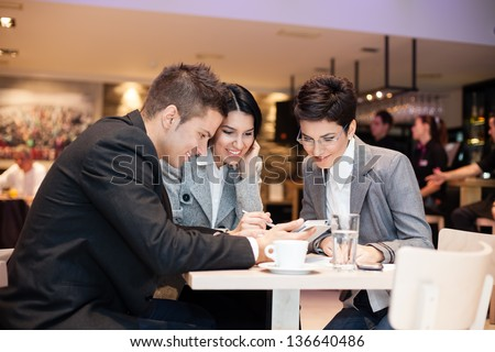 businesspeople having leisure time together in  cafe - stock photo