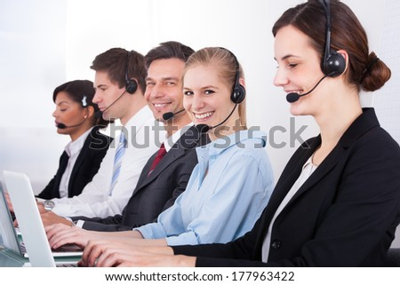 Businesspeople In A Row Wearing Headset Working At Office - stock photo