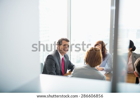 Businesspeople in conference room - stock photo