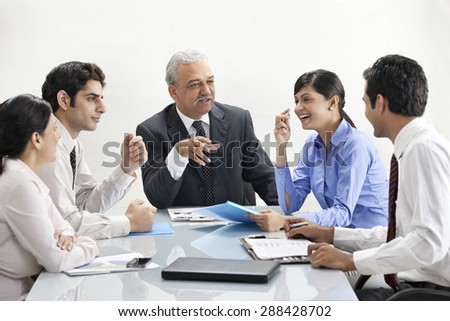 Businesspeople in happy discussion together - stock photo