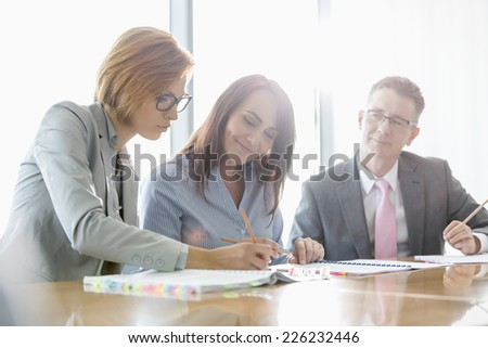 Businesspeople in meeting room - stock photo