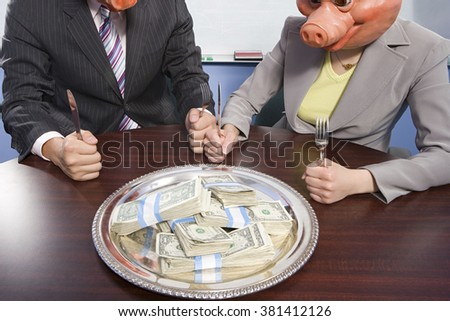 Businesspeople in pig masks sat in front of money - stock photo