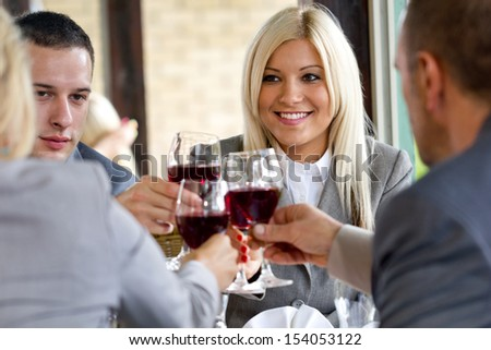 Businesspeople in restaurant having a toast