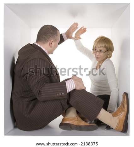 businesspeople in the small white cube - high five - stock photo