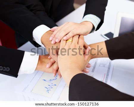 Businesspeople join hands concept working together or teamwork - stock photo
