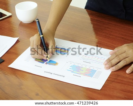 Businesspeople looking at documents in office