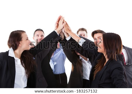 Businesspeople making high five gesture over white background