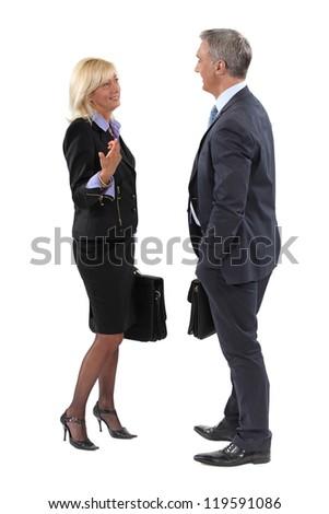 Businesspeople making small talk - stock photo