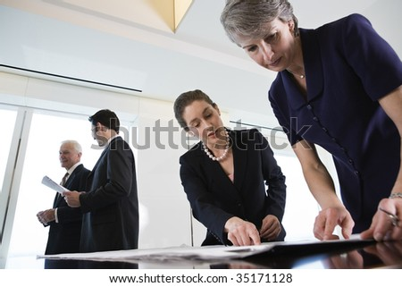 Businesspeople planning - stock photo