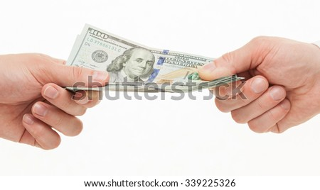 Businesspeople's hands holding dollars, white background - stock photo