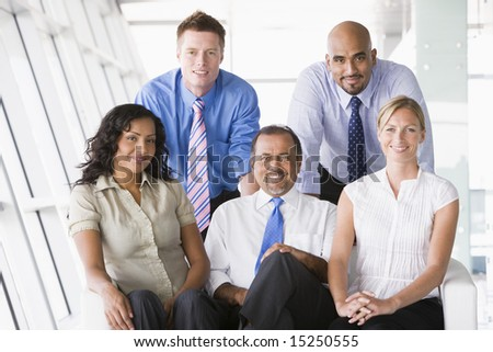 Businesspeople sitting in office lobby - stock photo