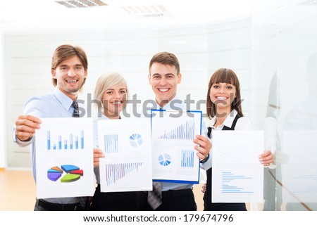 Businesspeople smile hold clipboard paper report document with finance chart, diagram, business people analyst team work group during conference, accounting meeting at office - stock photo