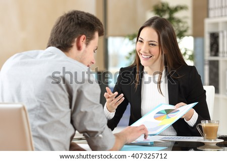 Businesspeople smiling coworking commenting and showing growth graphic and taking a business conversation in an office interior - stock photo