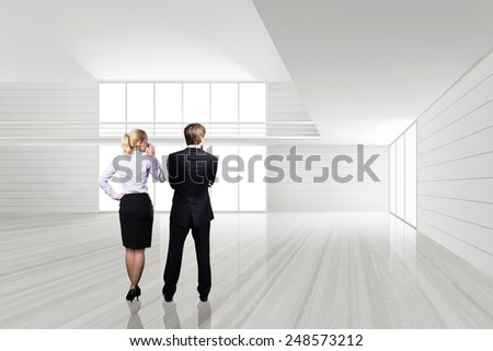 businesspeople standing in an empty space - stock photo