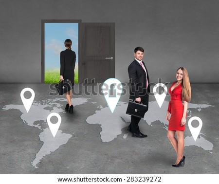 Businesspeople standing in the room on a map - stock photo