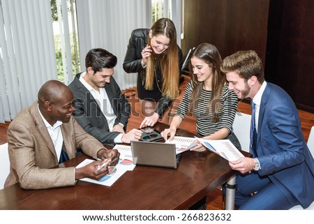 Businesspeople, teamwork. Group of multi-ethnic busy people working in an office