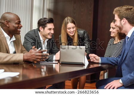 Businesspeople, teamwork. Group of multi-ethnic busy people working in an office - stock photo
