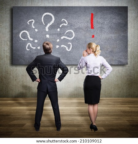 businesspeople thinking about a problem and one of them has the solution - stock photo