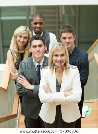 Businesspeople with a woman in the middle in an office - stock photo