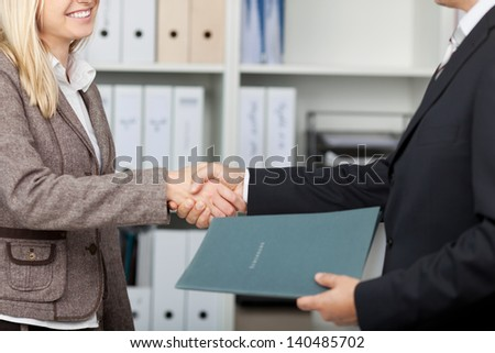 businesspeople with cv shaking hands after an interview - stock photo