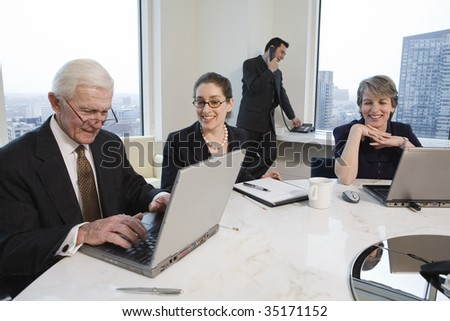 Businesspeople with laptops. - stock photo
