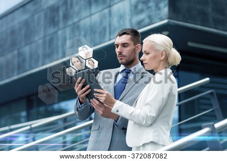 businesspeople with tablet pc outdoors - stock photo