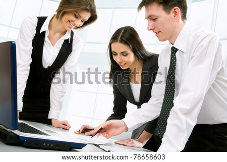 Businesspeople work at modern office