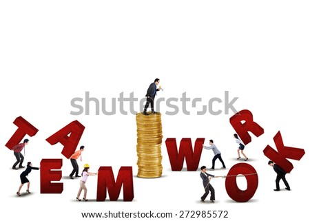 Businesspeople work together to arrange a teamwork text, isolated on white background - stock photo