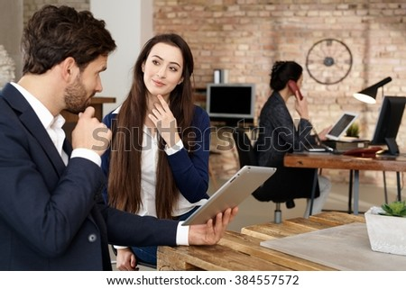 Businesspeople working in office, using tablet computer. - stock photo