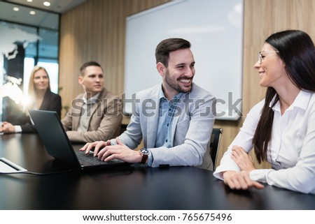 Businesspeople working on computer in conference room