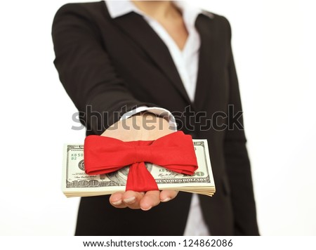 Businessperson giving generous bonus as a corporate gift - stock photo