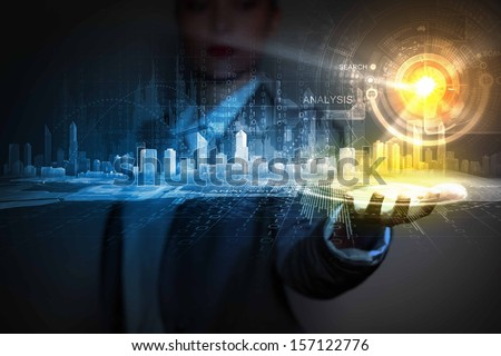 Businessperson holding media image of city in palm. New technologies - stock photo