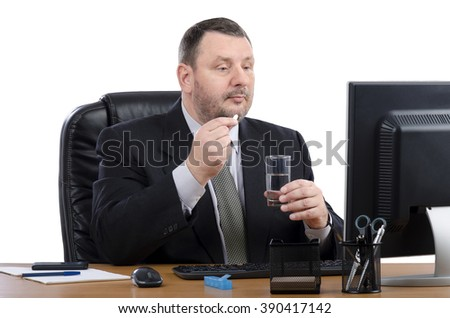 Businessperson takes white pill during virtual doctor visit. Bearded man has a telemedicine consultation service for the time of his lunch. Horizontal shot.