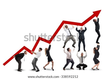 Businessperson working together to raise an arrow - stock photo