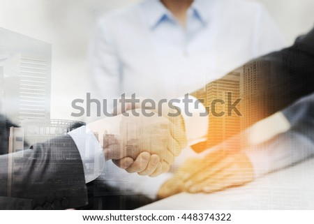 businesss and office concept - two businessmen shaking hands in office - stock photo