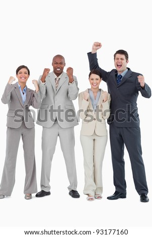 Businessteam cheering together against a white background - stock photo