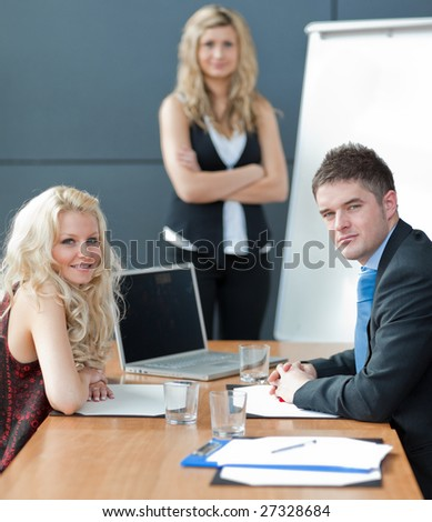Businessteam in a office - stock photo