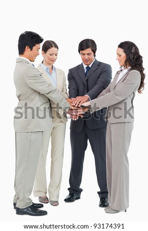 Businessteam performing self motivation ritual against a white background
