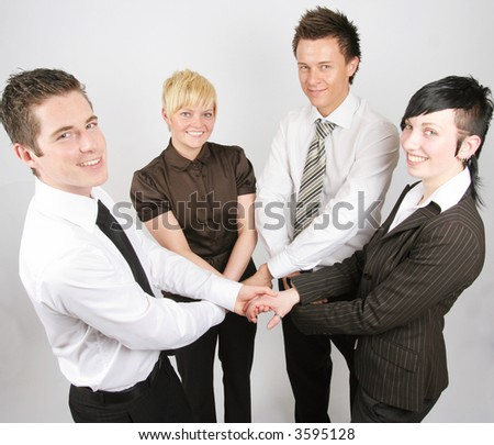 businessteam shaking and holding hands