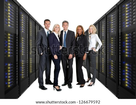 Businessteam standing on front of two lines of server racks. Isolated on white background - stock photo