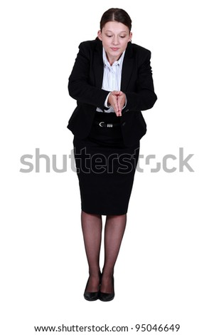 Businesswoman about to dive - stock photo