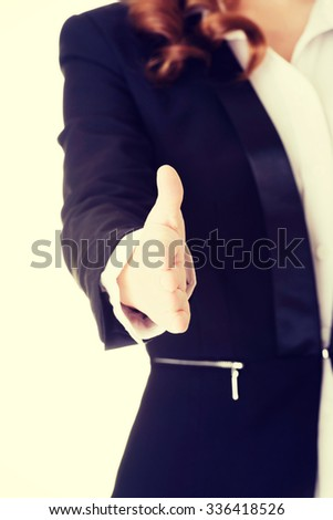 Businesswoman about to shake hands - stock photo