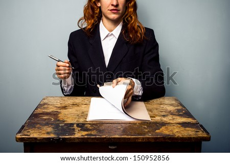 Businesswoman about to sign contract - stock photo