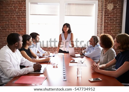 Businesswoman Addressing Boardroom Meeting
